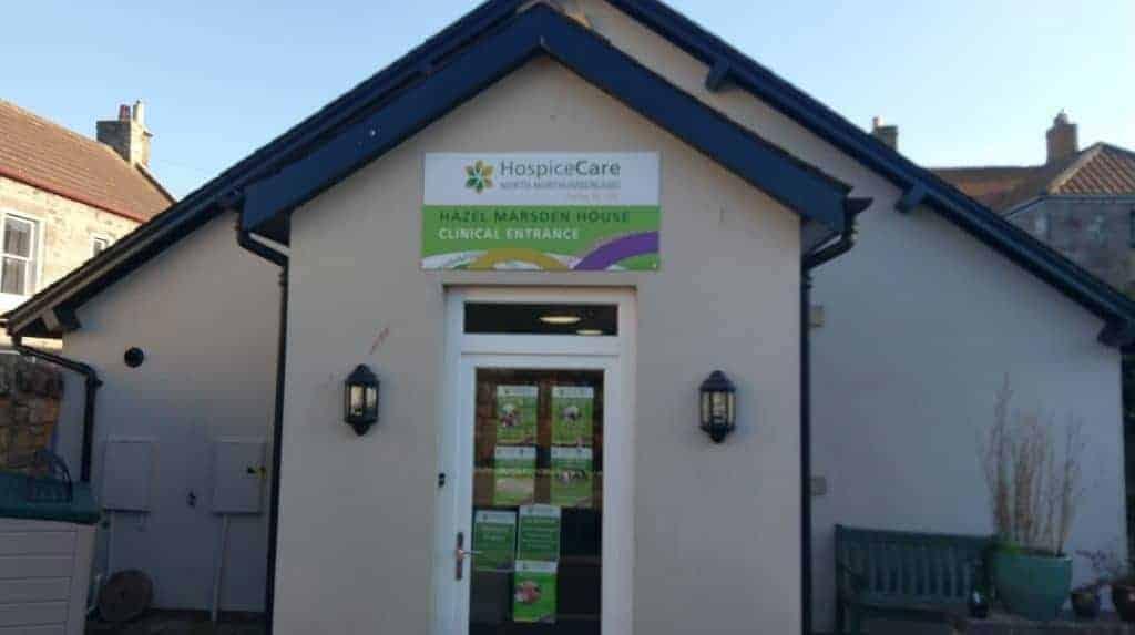 Metal sign above door at Hospice Care Berwick-upon-Tweed